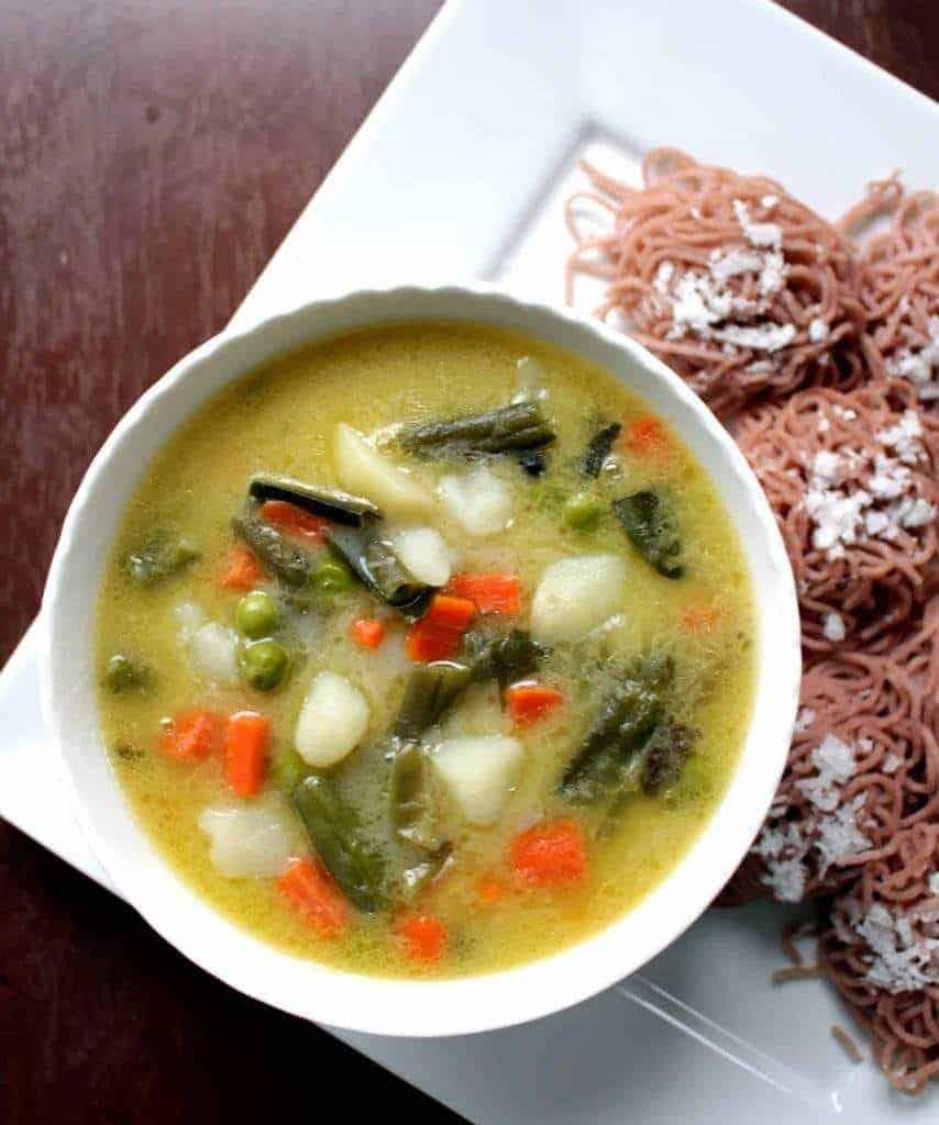 Vegetable stew served with idiyappam