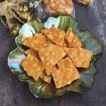 peanut brittle in a green bowl