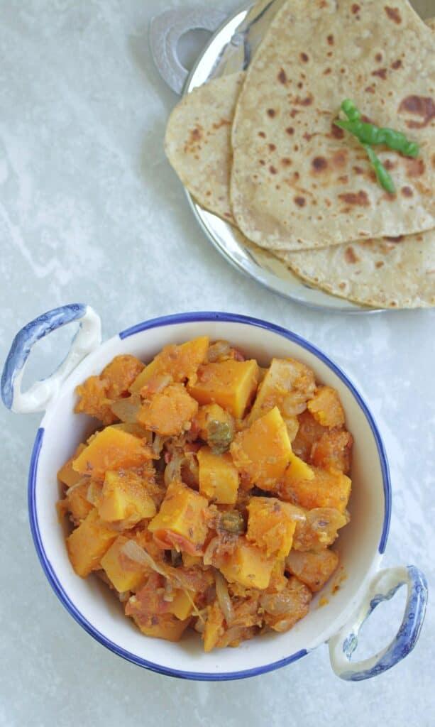Pumpkin curry in a white bowl