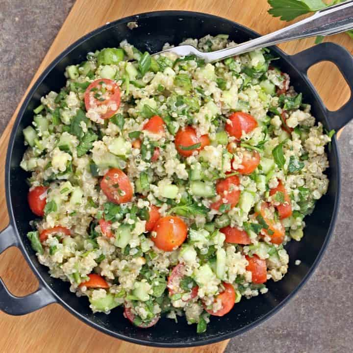 Quinoa Tabbouleh salad in a black plate